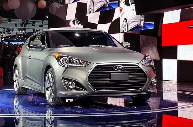 Купе Hyundai Veloster Turbo, модель 2013 года.  Южнокорейская компания Hyundai продолжает завоевывать автомобильные рынки. На детройтском автосалоне она представила двухместное купе с новым турбо двигателем