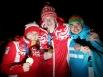 Россияне Анастасия Седова и Александр Селянинов и Сергей Малышев из Казахстана (слева направо) на церемонии награждения во время I зимних юношеских Олимпийских игр.