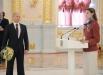 Президент РФ Владимир Путин на торжественной церемонии вручения государственных наград российским олимпийцам в Александровском зале Большого Кремлевского дворца. Справа - легкоатлетка Анна Чичерова.