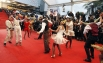 """<a href=""""http://www.aif.ru/news/news/news_id/370743"""">Танцевальный сюрприза для гостей. </a> У Дворца фестивалей появились два ретромобиля с танцорами, которые исполнили танец на красной дорожке под «A Little Party Never Killed Nobody» в исполнении Ферджи"""