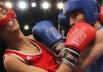 Корейский спортсмен Сангмин Лии (слева) и российский спортсмен Адлан Абдурашидов во время полуфинального боя турнира по боксу в весовой категории до 60 кг