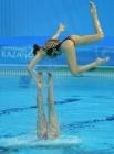 Команда России выступает в произвольной программе финальных соревнований по синхронному плаванию на XXVII Всемирной летней Универсиаде 2013 в Казани.