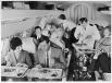 Стюард и стюардесса в начале 1960-х  Сначала функции бортпроводников выполняли мужчины — чаще всего ими были бывшие официанты дорогих ресторанов.