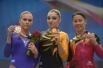 Призеры соревнований по легкой атлетике в метании диска среди женщин во время церемонии награждения (слева направо): Елена Панова (Россия) - серебряная медаль, Вера Ганеева (Россия) - золотая медаль, Марика Оберхольцер (ЮАР) - бронзовая медаль
