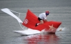 Участник команды «Высший пилотаж» Александр Ильичев прыгает с трамплина на фестивале самодельных летательных аппаратов Red Bull Flugtag