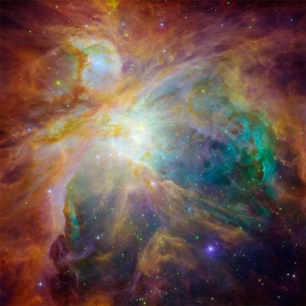 Туманность Ориона. Самая яркая диффузная туманность, её видно на небе невооружённым глазом за счёт свечения раскалённого газа. Расположена на расстоянии около 1344 световых лет. Фото сделано космическим телескопом «Спитцер» в инфракрасном диапазоне.