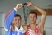 Валентин Юдашкин среди прочего разработал форму для олимпийской сборной России к ОИ-1996. На фото: чемпион Олимпийских игр в Атланте Олег Саитов со своим тренером Игорем Уткиным.
