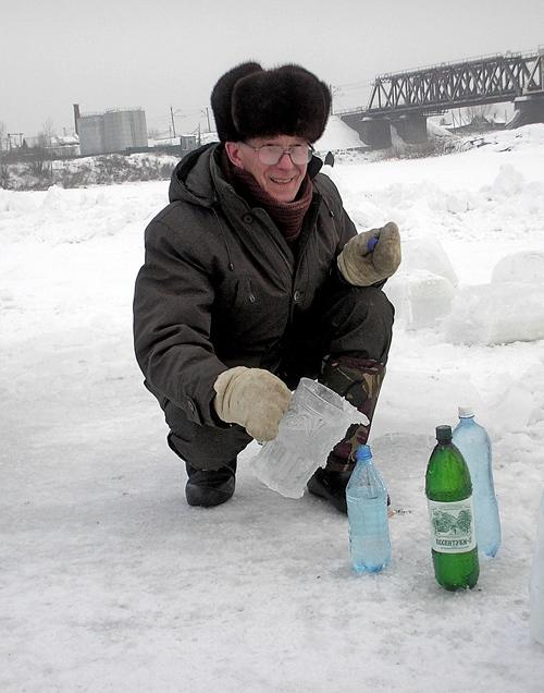 Председатель Яйского районного совета народных депутатов Николай Герасименко запасает святую воду для всего депутатского корпуса.