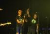 По окончанию концерта трубочист кинул в зал три бутылки воды, потому что судя по публике все жаждали воды, а барабанщик подарил залу свои палочки