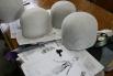 Прежде чем браться за ткань для будущих шляпок, сначала создают такие вот болванки