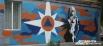«МЧС-Вумен». Автором шедевра «МЧС-Вумен» стал популярный уличный художник из Екатеринбурга. Талантливая девушка создала нового челябинского супер-героя на стене дома по Свердловскому  проспекту 80.