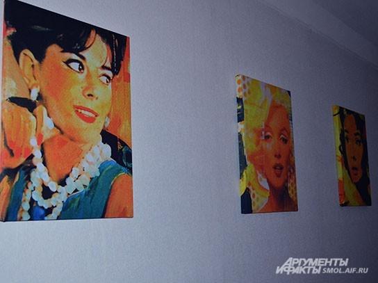 Стены украшены стильными портретами голливудских кинодив прошлого