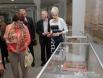 Экскурсовод рассказывает первым посетителям об экспонатах выставки «Русь православная».