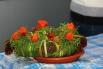 Флористы считают, что каждый венок, сплетенный вручную - это частичка души его создателя