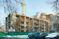 Обычное 4-этажное здание на ул. Мишина разрастается и вширь и ввысь.