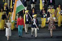 Загадочный член делегации сборной команды Индии Мадхура Хонди (в красном) на Олимпиаде в Лондоне, 2012 год.