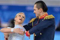 Татьяна Волосожар и Максим Траньков в короткой программе парного катания командных соревнований по фигурному катанию на XXII зимних Олимпийских играх в Сочи.