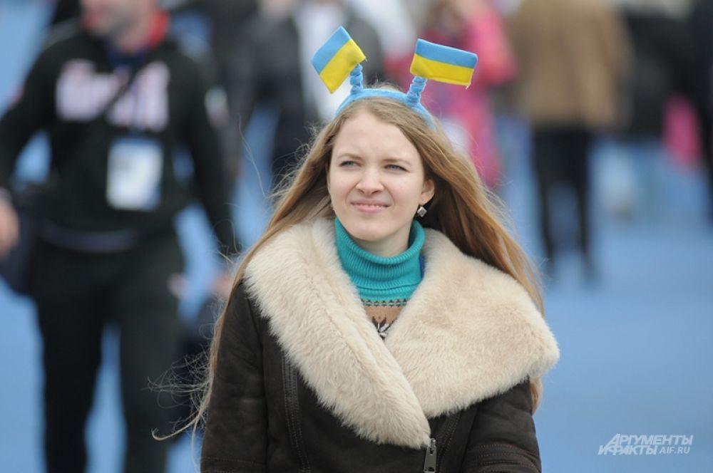 Несмотря на все передряги на родине в Сочи украинские болельщицы на несколько часов в Олимпийском парке забывали о насущном и отдавались всеобщему веселью царящего там праздника.