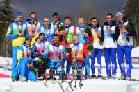 Награждение эстафетных команд в лыжных гонках.