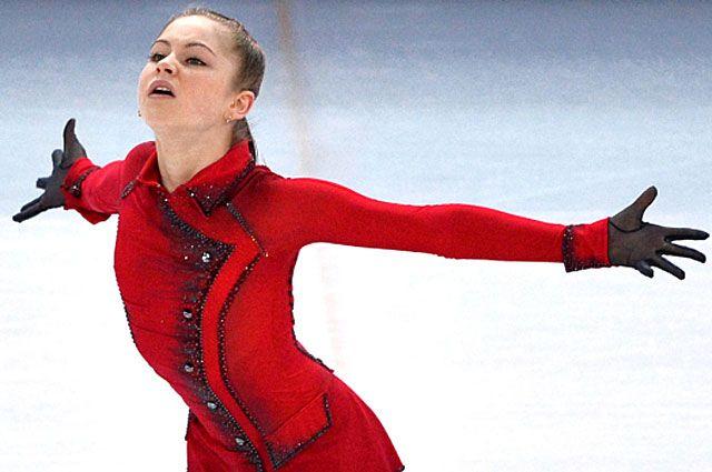 Юлия Липницкая в произвольной программе женского одиночного катания командных соревнований по фигурному катанию на XXII зимних Олимпийских играх в Сочи.