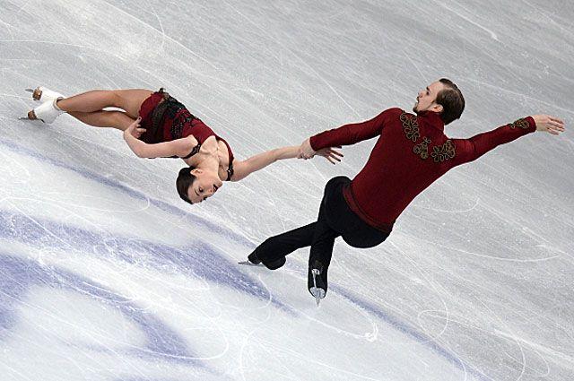 Ксения Столбова и Фёдор Климов в короткой программе парного катания на чемпионате мира по фигурному катанию 2014 года в Сайтаме.