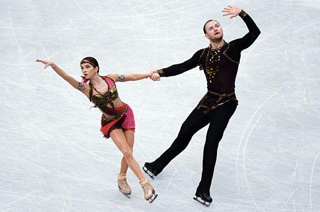 Вера Базарова и Юрий Ларионов в произвольной программе парного катания на Чемпионате мира по фигурному катанию 2014 года в Сайтаме.