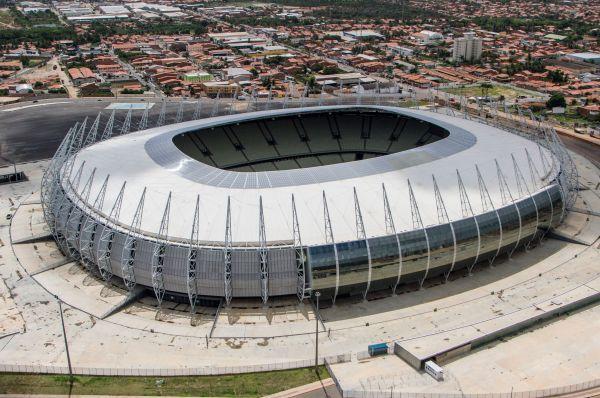 Стадион «Кастелан» в Форталезе был открыт ещё в 1973 году, а летом 1980-го победу Бразилии над Уругваем со счётом 1:0 с трибун смотрели 118 496 человек. К чемпионату мира стадион был перестроен, и теперь его вместимость стала ещё больше.