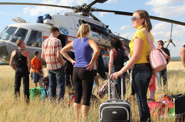 Вертолет перевозит до 20 человек.