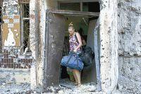 Украинская артиллерия продолжает разрушать города юго-востока.