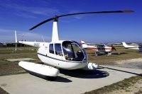 Вертолёт Robinson R44 на гидрошасси.