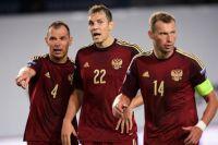 Игроки сборной России Сергей Игнашевич, Артем Дзюба и Василий Березуцкий (слева направо)