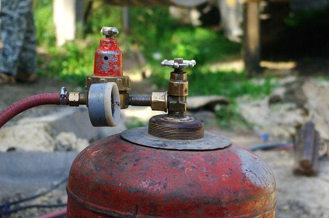 Баллон с бытовым газом пропан-бутан.