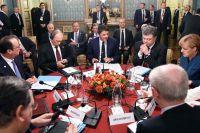 Владимир Путин на встрече с Ангелой Меркель, Франсуа Олландом и Петром Порошенко в Милане.