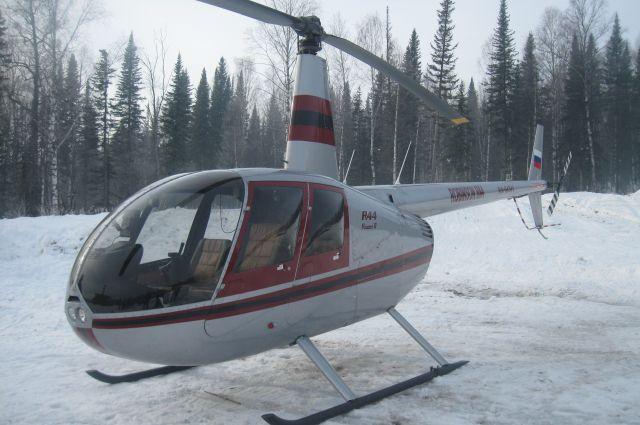 Вертолет Robinson.
