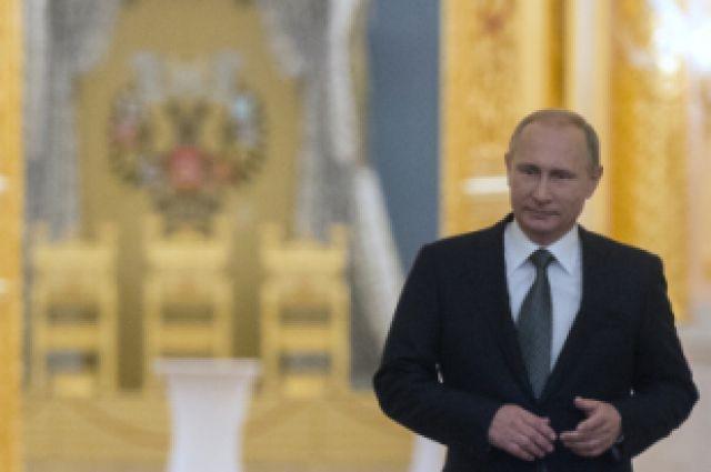 4 декабря 2014. Президент России Владимир Путин перед началом оглашения ежегодного послания президента Российской Федерации Федеральному Собранию в Георгиевском зале Кремля.