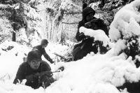 Американские солдаты 75-й пехотной дивизии в Арденнах.