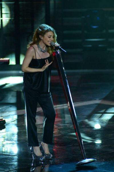 Тина Кароль на выступлении в шоу «Голос страны» (2013 г.)