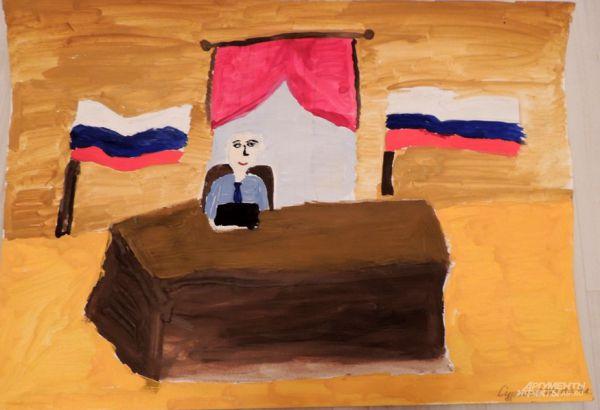 Сурганов Женя (8 лет) изобразил скучающего чиновника за пустым столом. В руках у него секретный черный ящик.
