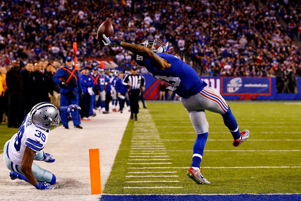 Эл Белло, фотограф Getty Images, занял второе место в категории «Спорт». На фото Оделл Бекхэм (# 13) из New York Giants ловит мяч одной рукой в матче против Dallas Cowboys на стадионе MetLife в Ист-Рутерфорд, Нью-Джерси.