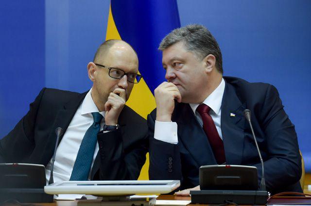 Глава правительства Арсений Яценюк и президент Украины Пётр Порошенко.