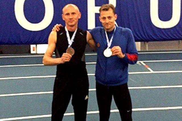 Легкоатлет Станислав Лепик (справа).