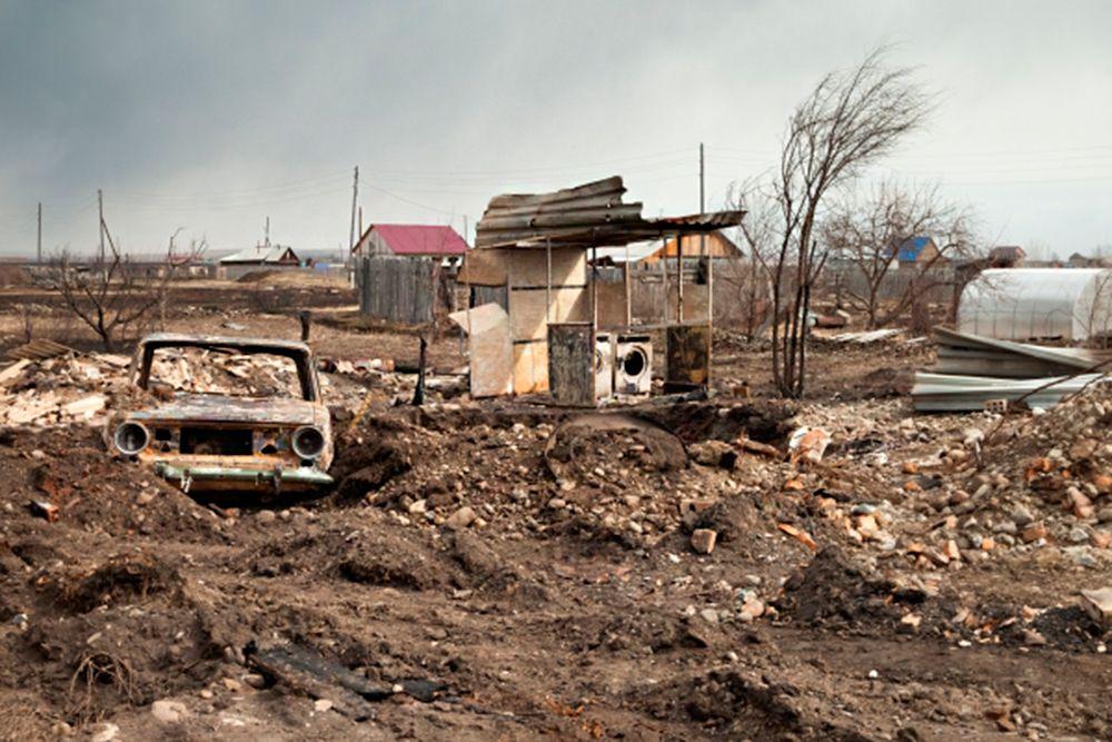 Последствия пожара в деревне Новоенисейка Республики Хакасия.