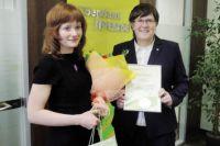 Ольга Секирина (слева) стала 20-миллионным клиентом.