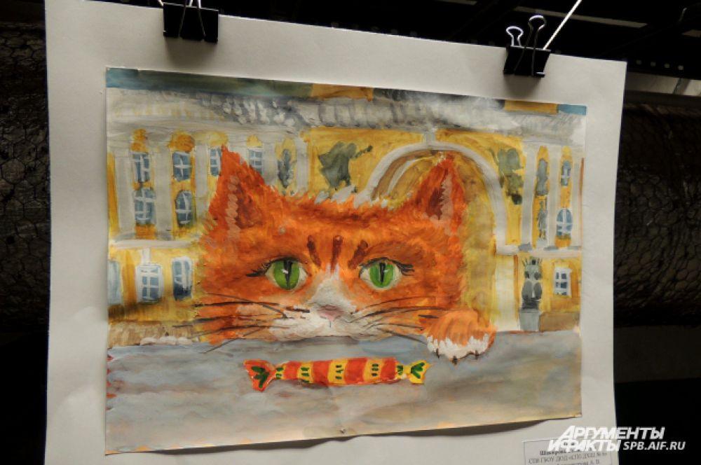 В подвале развесили рисунки с котами.