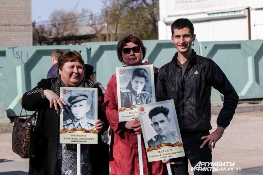 Некоторые семьи принесли на акцию сразу несколько портретов своих близких.