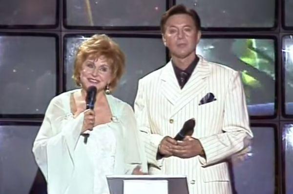 Телезрителям актер известен прежде всего как ведущий передачи «Песня года»: вместе с Ангелиной Вовк Меньшов вел ее с С 1988 по 2006 год.