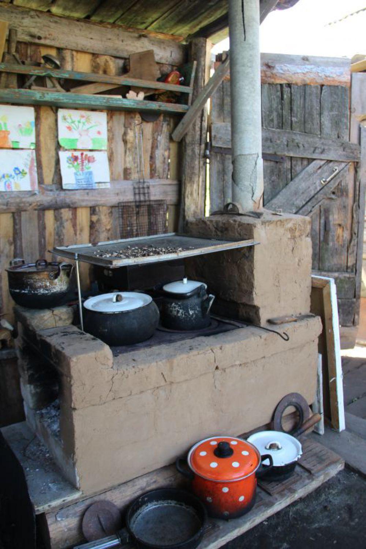Печка во дворе - тоже его работы.