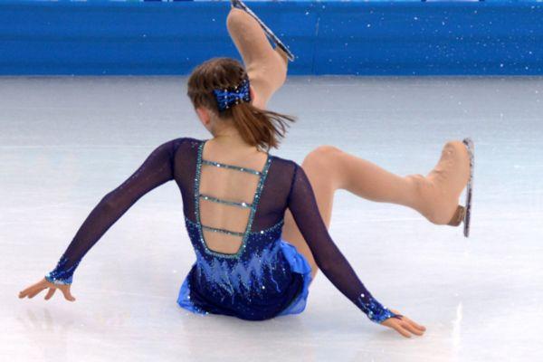 Юлия Липницкая выступает в короткой программе женского одиночного катания на соревнованиях по фигурному катанию на XXII зимних Олимпийских играх в Сочи. 2014 год.