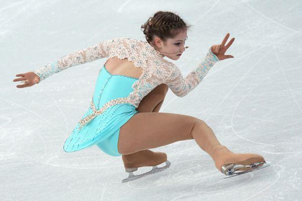 Юлия Липницкая выступает в произвольной программе женского одиночного катания на чемпионате России по фигурному катанию в Сочи. 2014 год.
