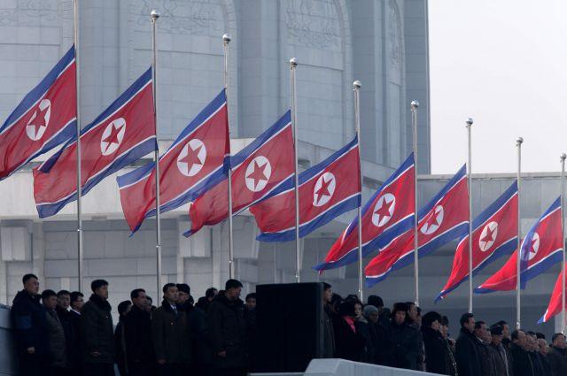На демонстрации в городе Пхеньян, КНДР.